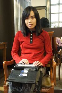 WeCo Lead Test Consultant, Nina, using her Braille display.