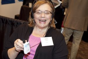 WeCo Certified Test Consultant using a hearing amplification device.