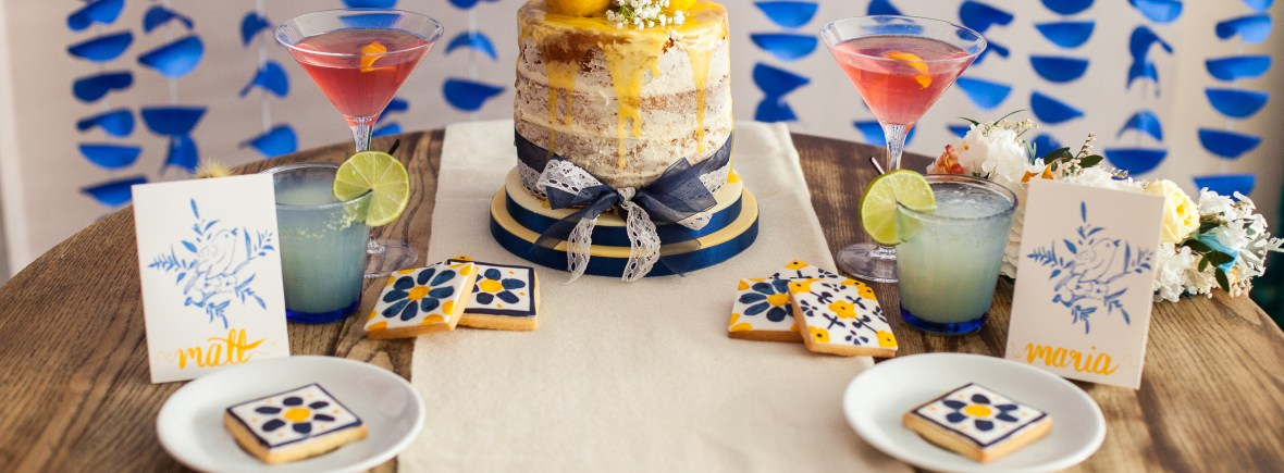 Blue and yellow styled shoot, naked cake, cocktails, backdrop and biscuits