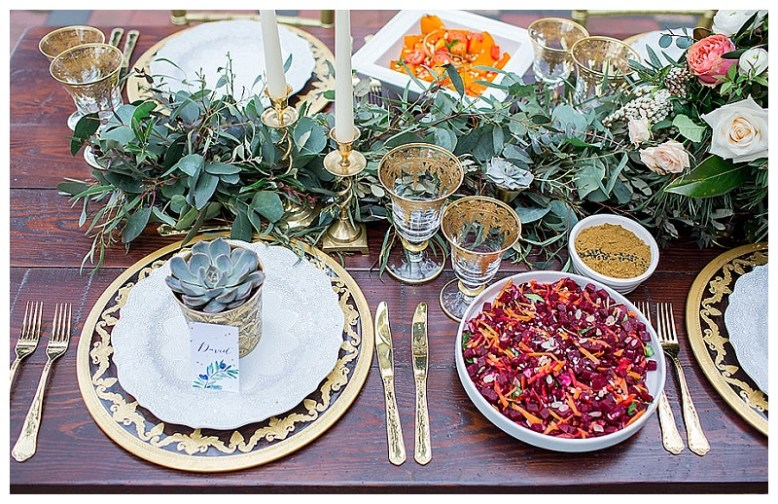 Roasted vegetable salads in jewel tones sit on a luxe styled table for a modern Moroccan styled shoot.
