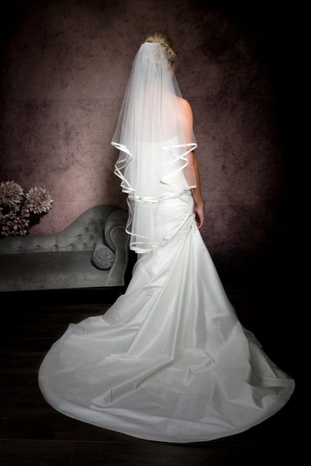 Brittany – two tier fingertip length veil with satin edging