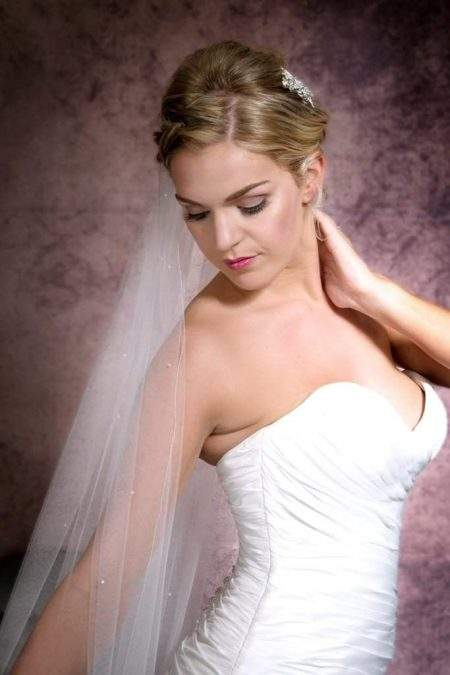 Close up portrait of bride wearing a one layer chapel length veil