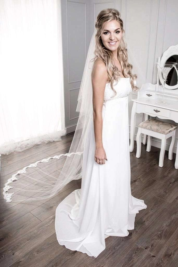 Bride wearing veil with half up half down hair