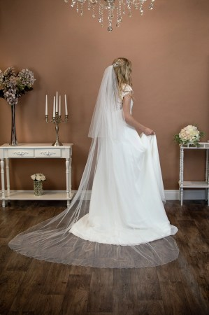 Paige - two layer long chapel length plain wedding veil on a bride
