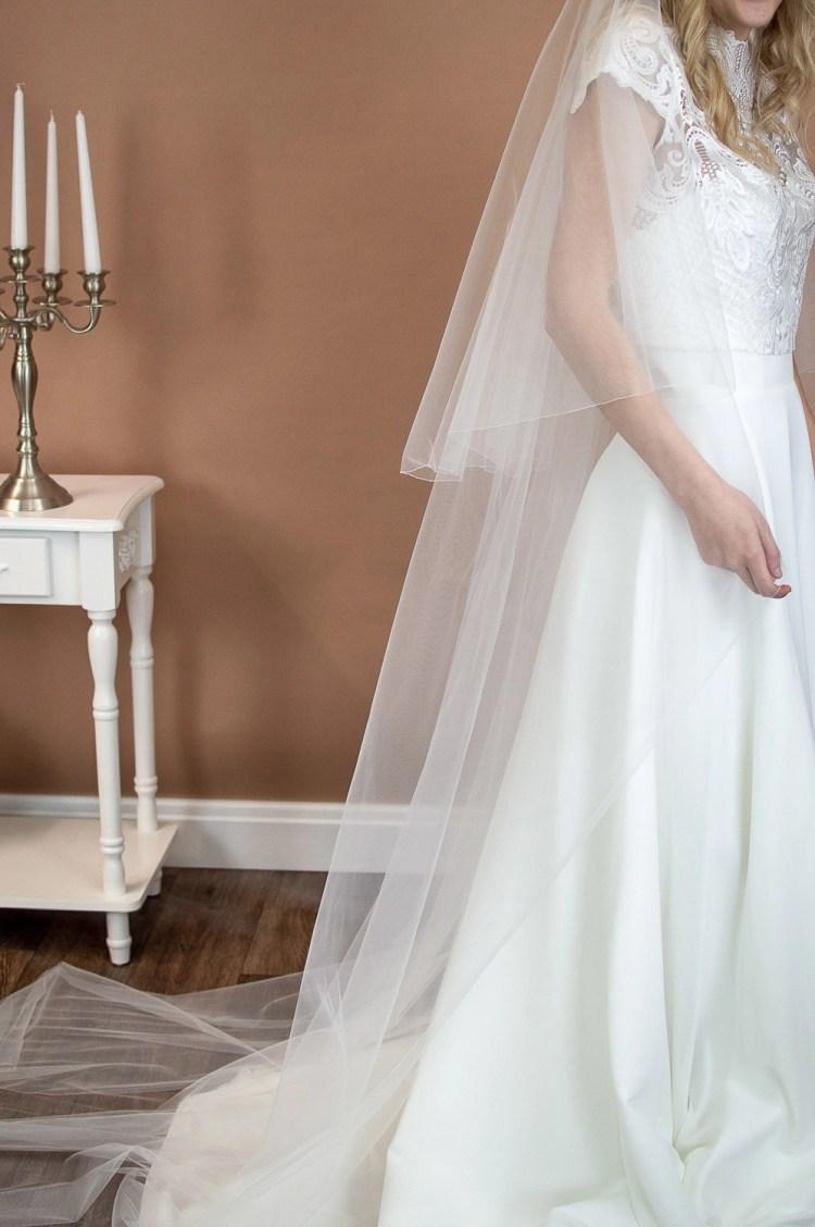 Paige - two layer chapel length plain wedding veil side view bridal portait