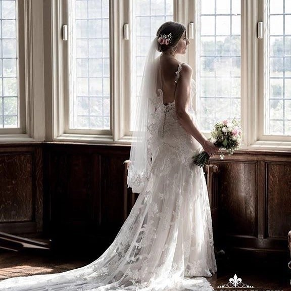 Fingertip length lace edge veil on real bride Sarah