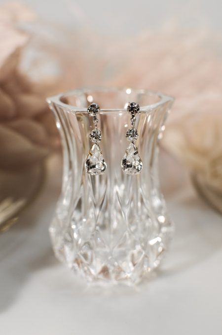 tls1547 earrings on glass