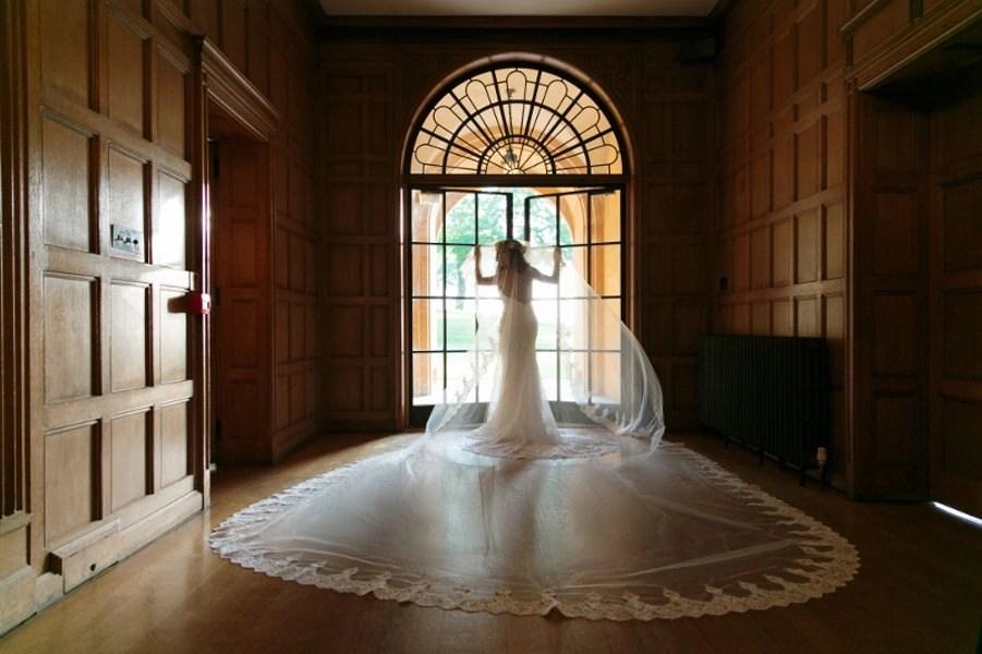 Bride wearing 5m lace mantilla veil (Meghan Markle veil)