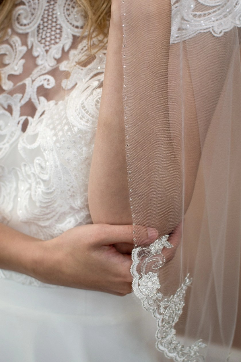 Alana - single layer hip length veil with silver and ivory lace topped with a hand beaded edge closeup