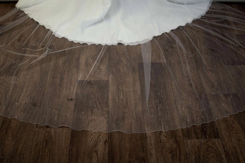 Alexis - cathedral length wedding veil with pearls and crystals on bride detail