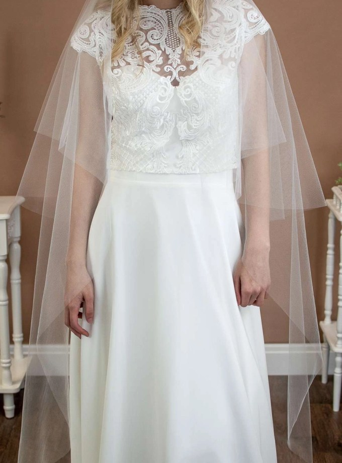 Angelina - two layer plain wedding veil with a hand cut edge in waltz length closeup front view
