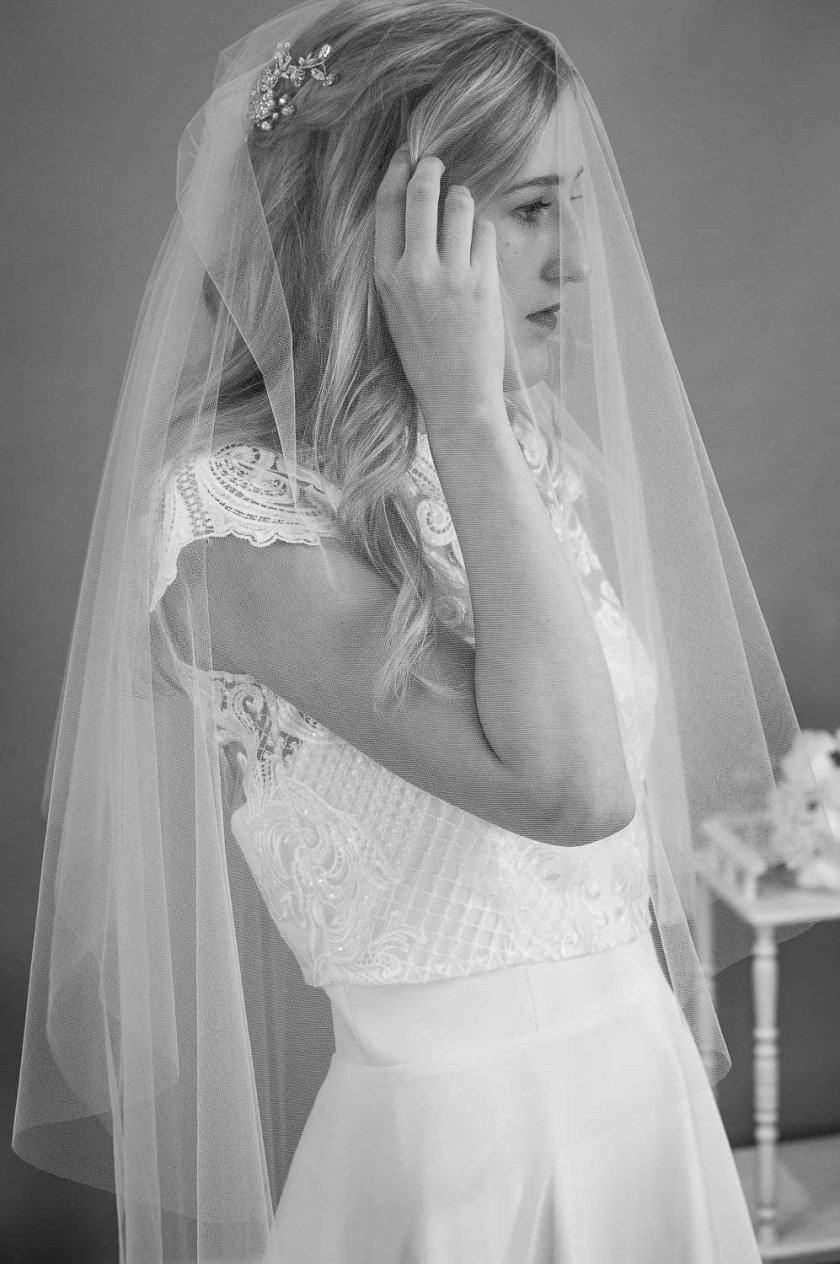 Angelina - two layer plain wedding veil with a hand cut edge in waltz length closeup side view bw alt