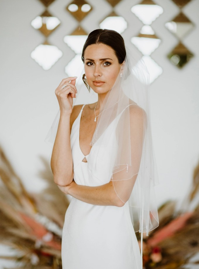 Danika - two layer waist length wedding veil with a scalloped edge & teardrop crystals