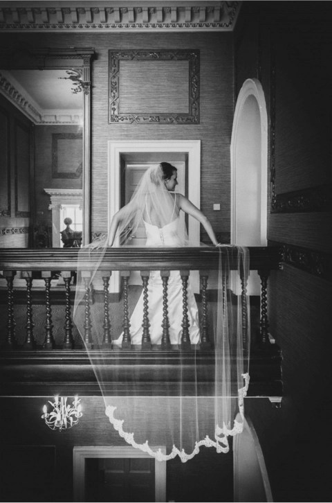 Emma wears a custom made cathedral lace bottom wedding veil