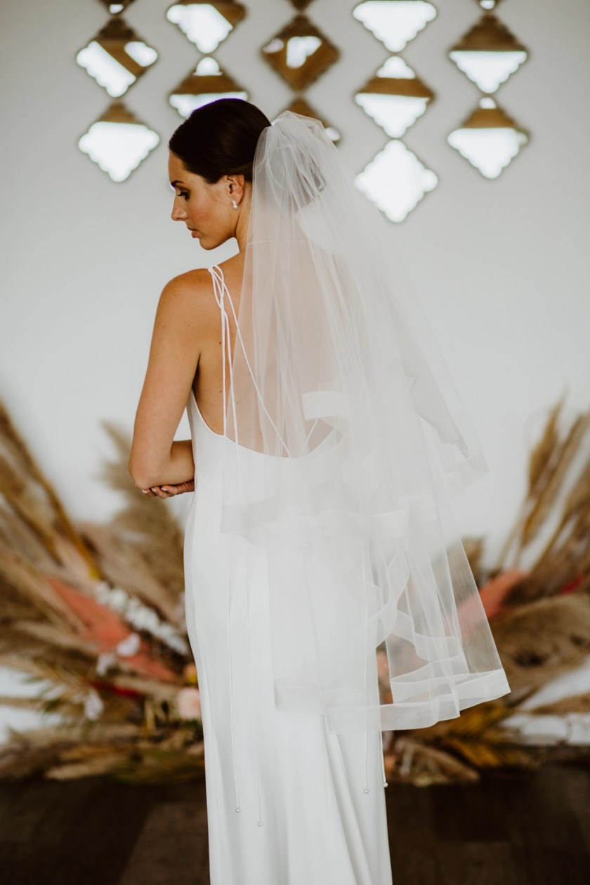 Fearne - two tier fingertip length veil with a wide sheer ribbon edge