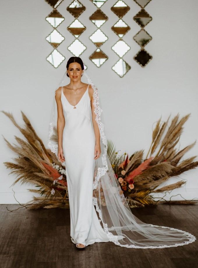 Harmony – single layer chapel length lace edged mantilla veil with comb