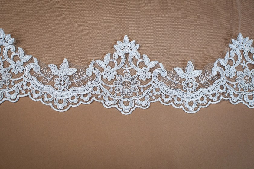 Harmony - single layer chapel length lace edged mantilla veil with comb closeup on solid background (3)