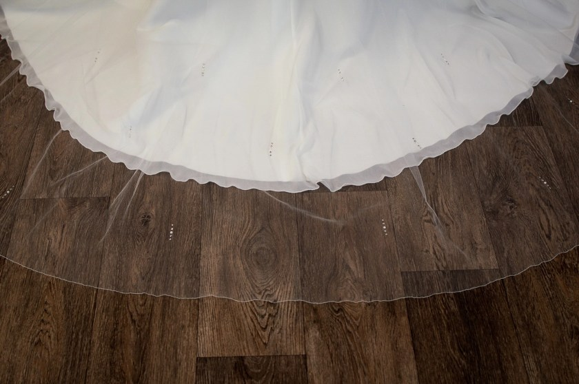 Lola - one layer chapel length veil with a pearl and diamante design detail