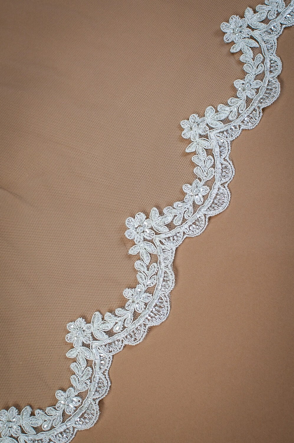 Paris - one tier chapel length veil with beaded scalloped lace edging closeup on solid background (2)