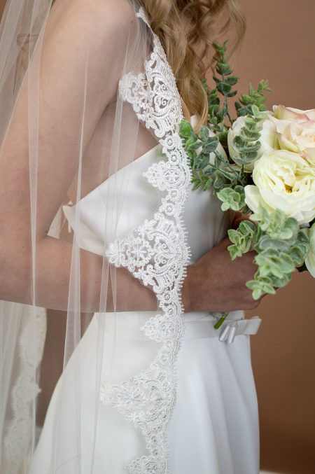 Sienna - one layer chapel length veil with a full lace edge closeup of lace