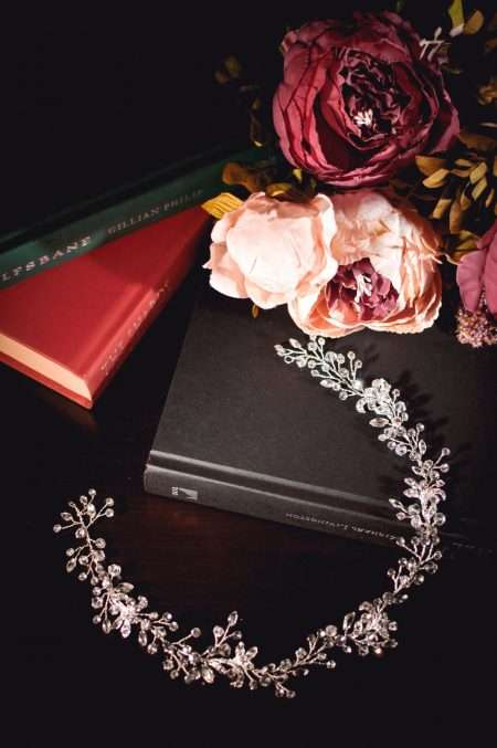 Neptune - crystal & diamante hair vine with floral accents on books TLH3076sil