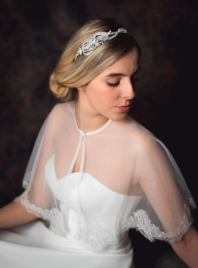 Vivien - pearl & diamante side headband with a scrolling design on a model bride TLT4578