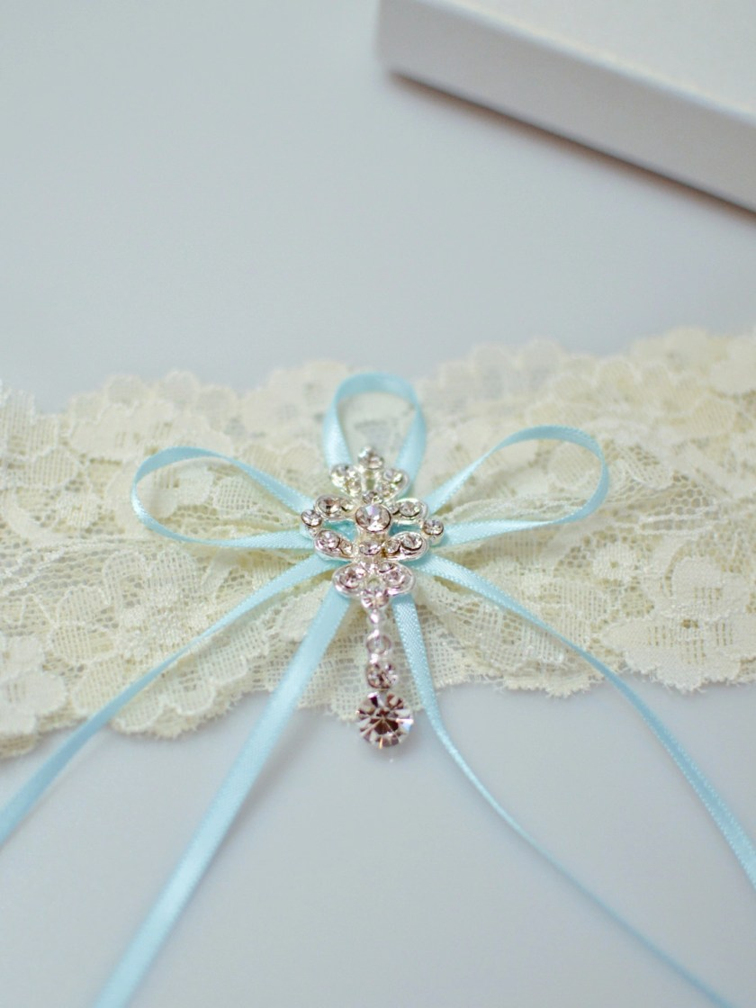Gorgeous flat lace bridal garter with crystal drop closeup TLG515
