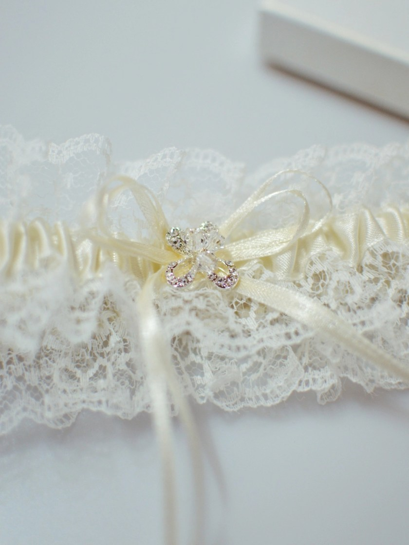Pretty wedding garter with crystal detailing closeup TLG512