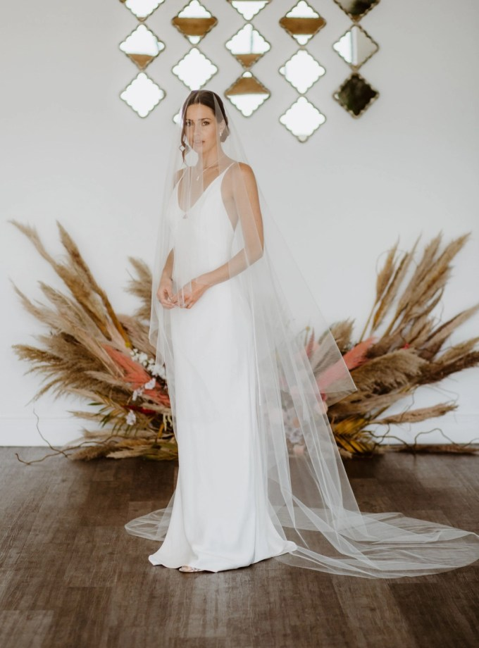 CAITLYN – two layer chapel length veil with a cut edge and extra long blusher