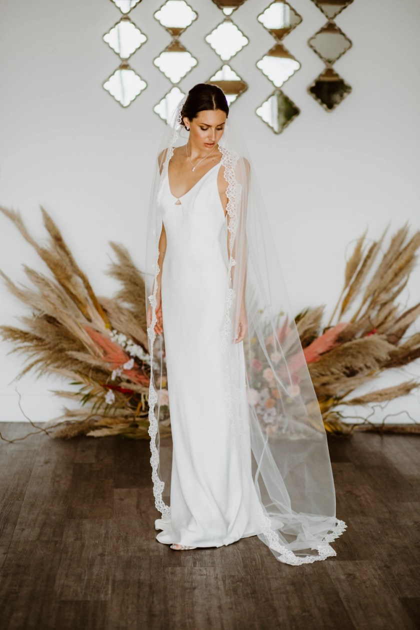 Astrid - one layer chapel length wedding veil with a full lace edge