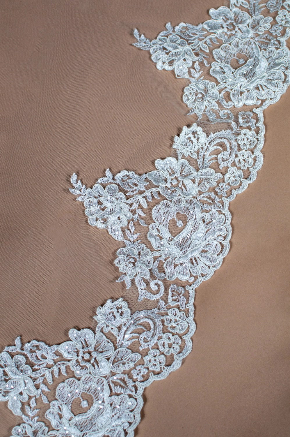 Layla lace edging for wedding veil on solid background closeup