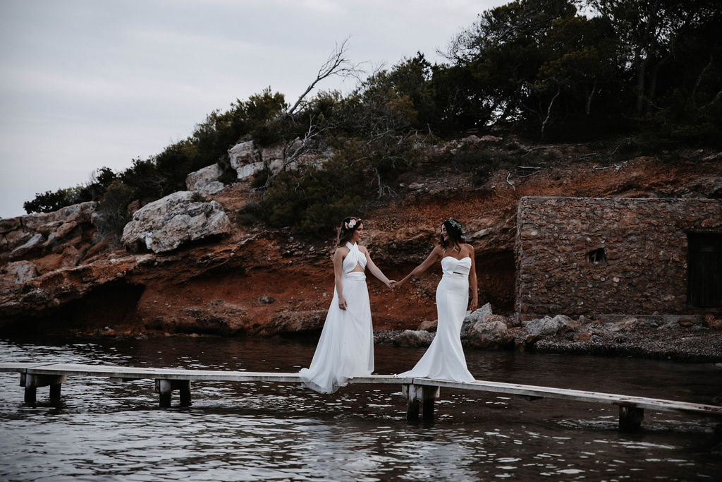 two brides in wedding dresses