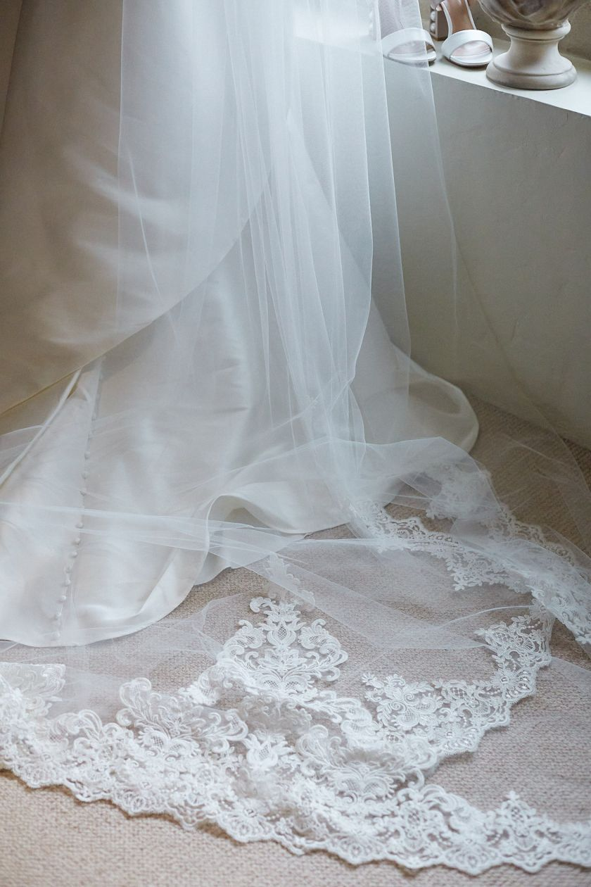 Bride Derrina Jebb and Simon Thomas in cathedral veil at Norwich cathedral
