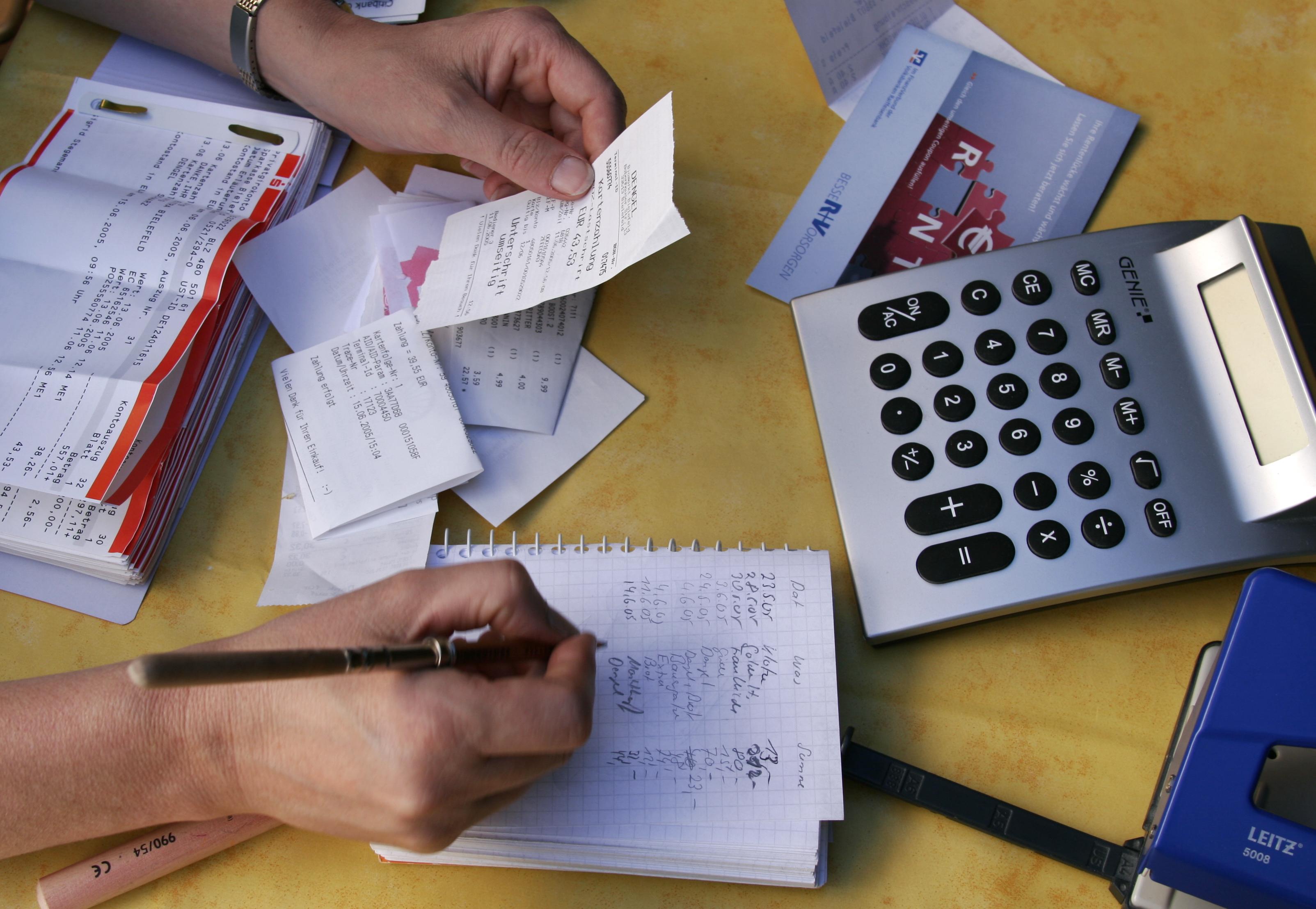 Woman doing accounts / accounting / financial accounts