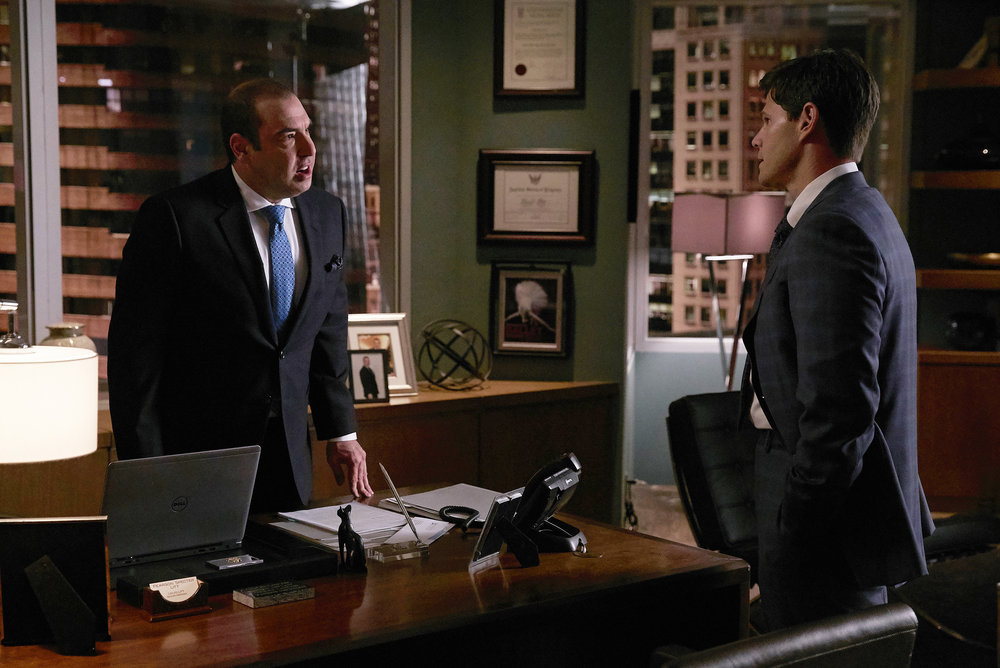 "SUITS -- ""P.S.L."" Episode 610 -- Pictured: (l-r) Rick Hoffman as Loius Litt, Ian Reed Kessler as Stu Buzzini -- (Photo by: Shane Mahood/USA Network)"
