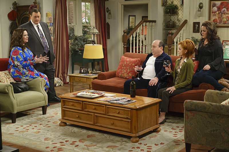 """""""The Adoption Option"""" --Mike and Molly need everyone to be on their best behavior when the adoption agency schedules a home visit, on MIKE & MOLLY, Monday, May 9 (8:30-9:00 PM, ET/PT) on the CBS Television Network. Pictured L-R: Melissa McCarthy as Molly Flynn, Billy Gardell as Mike Biggs, Louis Mustillo as Vince, Swoosie Kurtz as Joyce Flynn, and Katy Mixon as Victoria Flynn Photo: Hopper Stone/CBS ©2015 CBS Broadcasting, Inc. All Rights Reserved"""