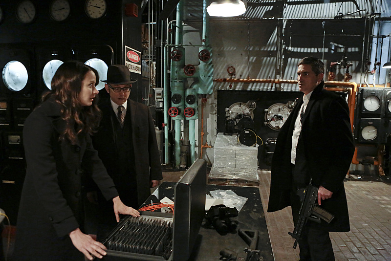"""YHWH"" -- Finch (Michael Emerson, center) and Root (Amy Acker, left) race to save The Machine, which has been located by the rival AI, Samaritan, while Reese (Jim Caviezel, right) is caught in the middle of the final showdown between rival crime bosses Elias and Dominic, on the fourth season finale of PERSON OF INTEREST, Tuesday, May 5 (10:01-11:00 PM, ET/PT) on the CBS Television Network.  Photo: Giovanni Rufino/Warner Bros. Entertainment Inc. © 2015 WBEI. All rights reserved."
