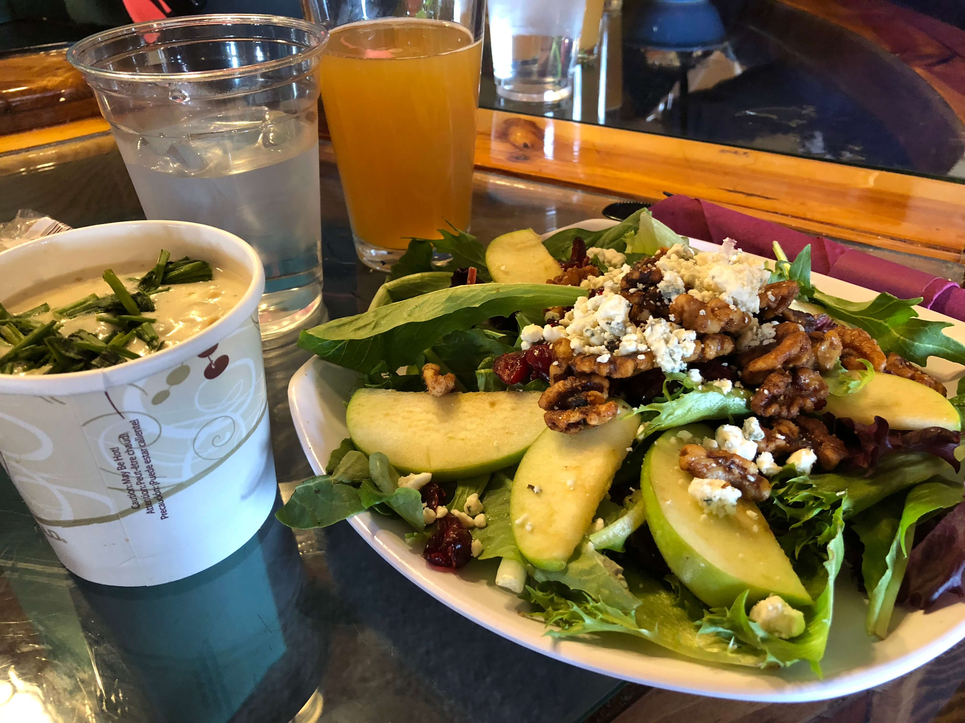 learning to ski as an adult at mount snow salad and beer