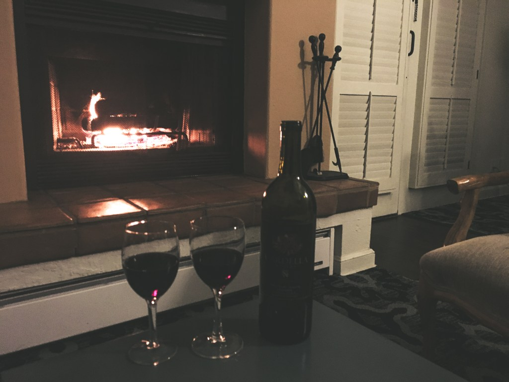 Wine by the fireplace at Hotel Pacific in Monterey, CA | TheWeekendJetsetter.com