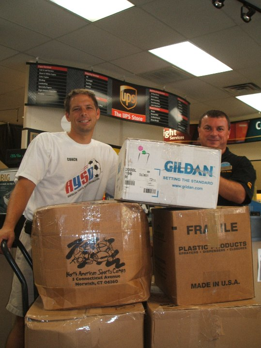 AYSO Regional Commissioner Chris Bull and The UPS Store Owner Arno Silva pictured with the Marathon AYSO donation to St.Peter's Prison Ministry