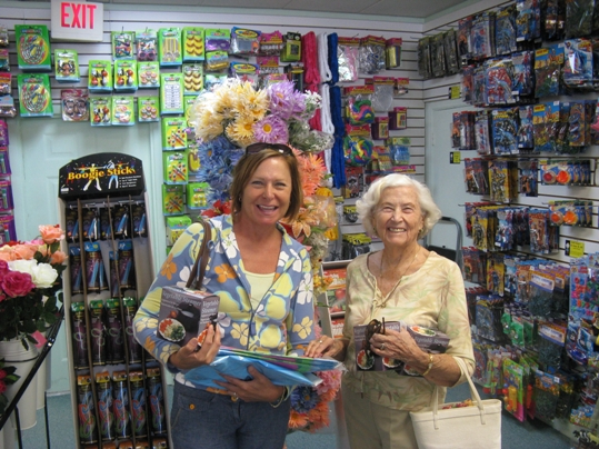 Marathon socialites May and Cora Baggs enjoy the neat order and vast selection of Daffy Doug's inventory