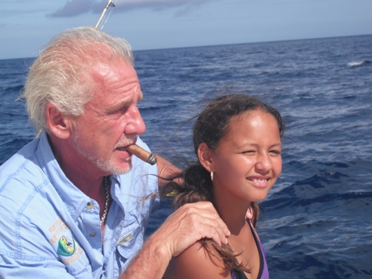 The commissioner with his granddaughter, Jayla, just before she caught and released a ten-foot shark