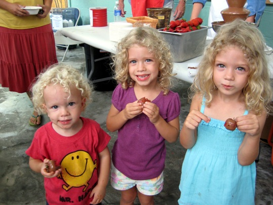 Last year, the Collins family was extremely pleased to find the fresh strawberries, but even happier to find the chocolate dipping fountain! Here three happy kids hold their personally hand dipped fresh strawberries covered in warm chocolate.