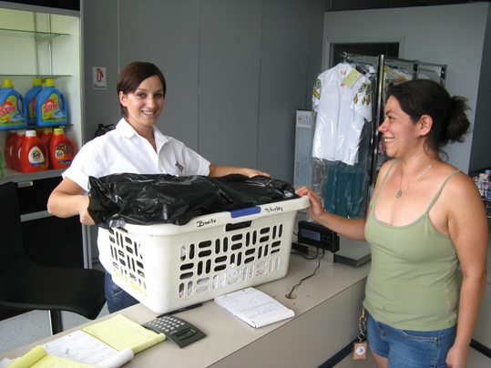 Romanian laundry diva, Tatiana Onofrei helps Melissa Cross, a former employee of the old Big Pine Laundromat, with her fresh laundry