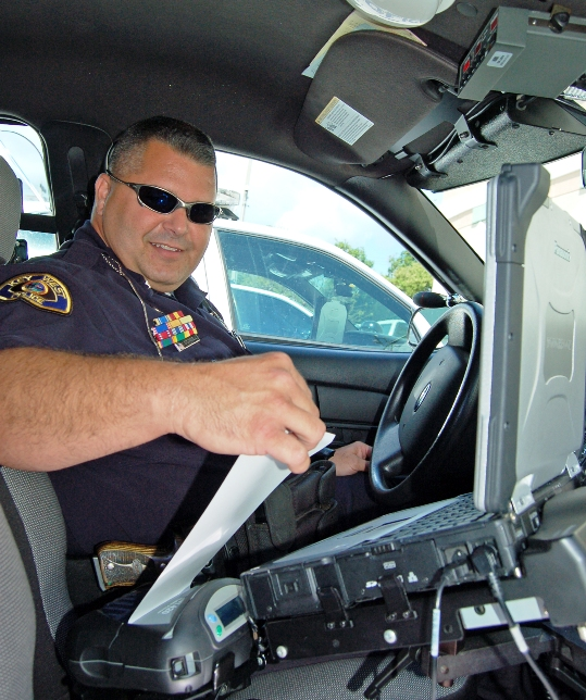 Officer Kevin O'Connell issues a ticket using the new, state-of-the-art ticketing system recently installed in his patrol car