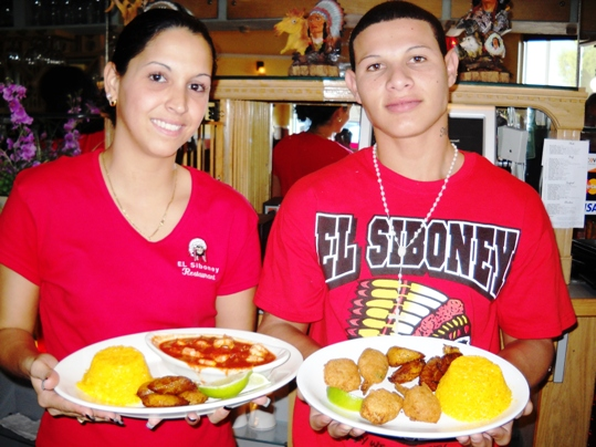 Vanessa Saez and Daniel Barrera present the Shrimp Enchilado and Stuffed Shrimp entrees that are accompanied by the requisite yellow rice, black beans and fried plantains