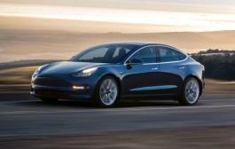 Elon Musk delays production of Tesla Model 3 - again