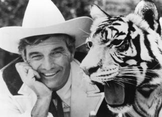 """Car dealer Cal Worthington and one of his many animals named """"Spot."""""""