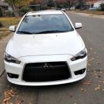 Menacing-looking front grille. 2014 Mitsubishi Lancer.