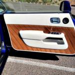 The inside door panels of the Rolls Royce Wraith are custom-made to a buyer's wood preferences.